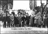 Toronto City officials with competitors in Toronto Stampede at war memorial, Toronto, Ontario.