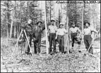 National Transcontinental Railway surveyors with instruments, Comet Lake, Ontario.